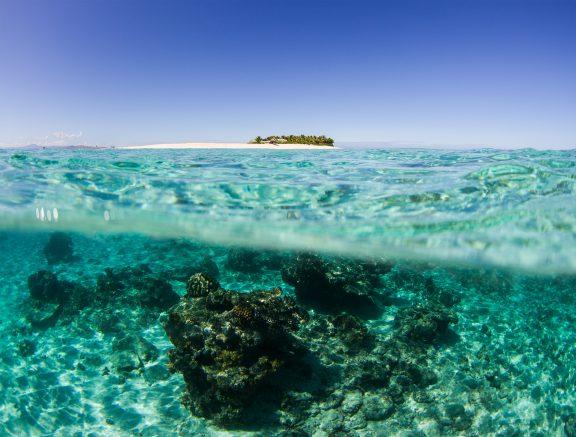 image of namotu island above clear blue water