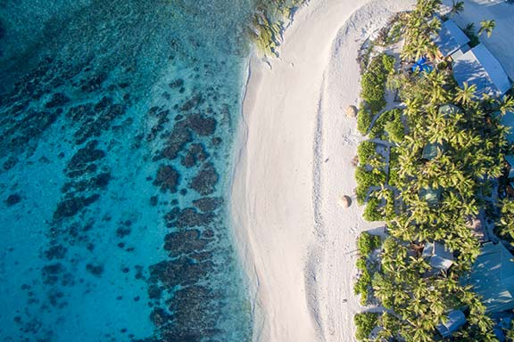 namotu-island-aerial-shot-of-white-sand-beach-and-palm-trees
