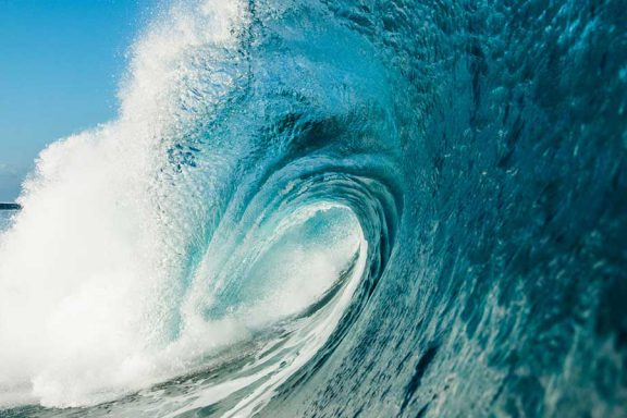 perfect-tube-wave-at-surf-break-near-namotu-island-fiji-banner