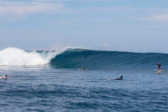 surfers-and-stand-up-paddle-boarder-at-surf-break-near-namotu-island-fiji