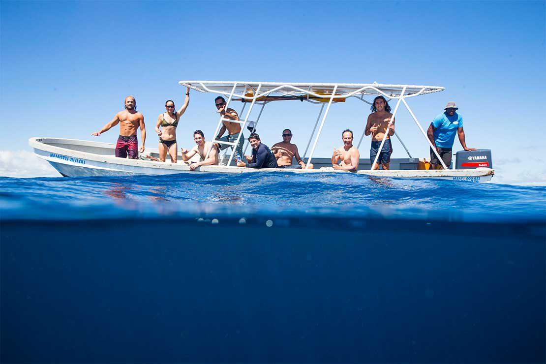 surfers-on-boat-namotu-island