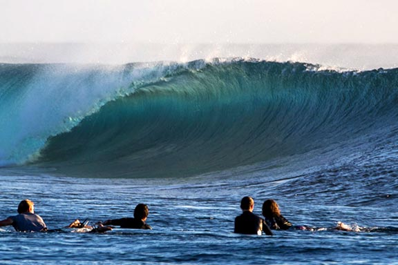 surfers-watching-barrel-wave-at-restaurants-surf-break-near-namotu-island-fiji