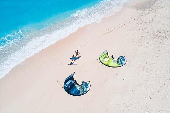 two-kite-surfers-and-kites-on-beach-at-namotu-sialdn-fiji